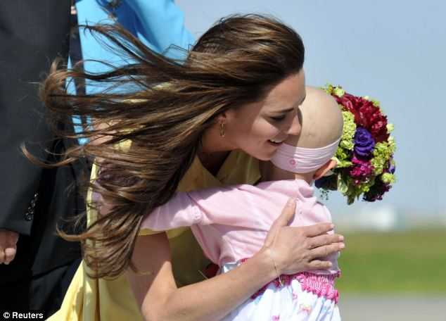 Kate with 6-year-old Diamond Marshall in Calgary in 2011, as she toured Canada with Prince William