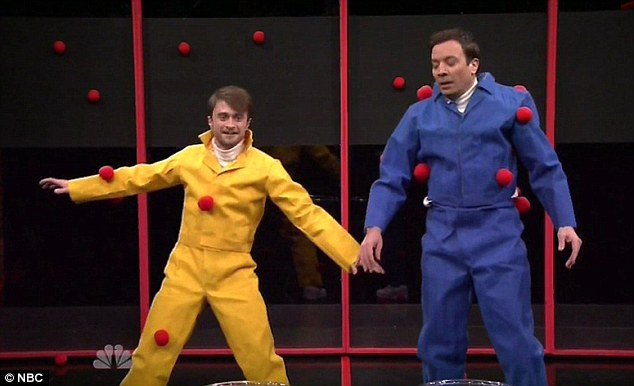 Child's play: Daniel Radcliffe didn't mind looking silly during a game of Sticky Balls with Jimmy Fallon during a Thursday appearance on The Tonight Show