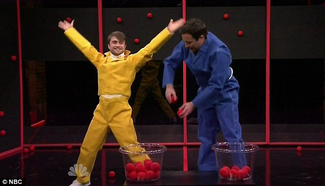 Game, set, match: Both Daniel and Jimmy slipped into Velcro suits and started off with an equal number of sticky red balls