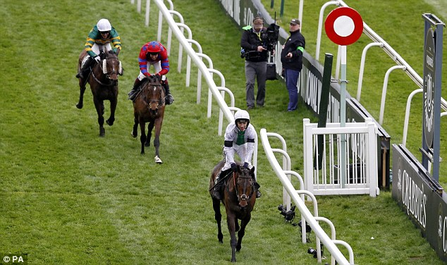 In the clear: Pineau De Re was five lengths clear of his rivals as he crossed the line