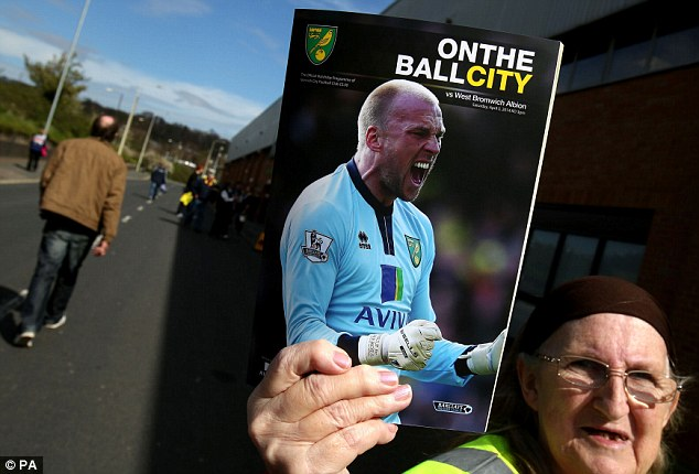 Get with the programme: Norwich program's cover star John Ruddy was helpless for the only goal of the match