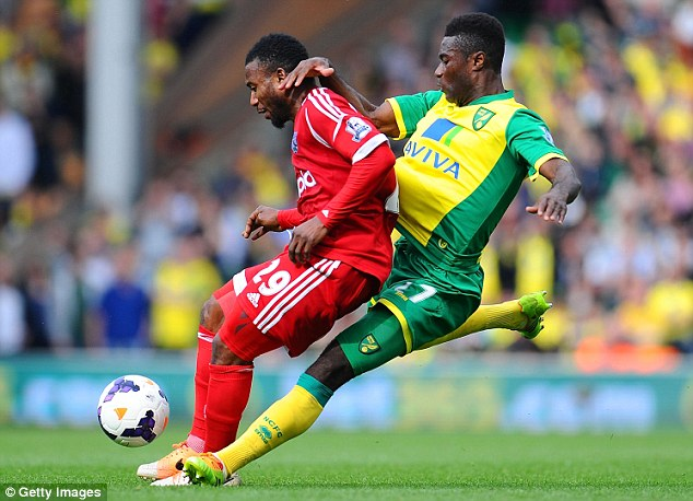 Route one: West Brom's Stephane Sessegnon braces himself as Alex Tettey tackles from behind