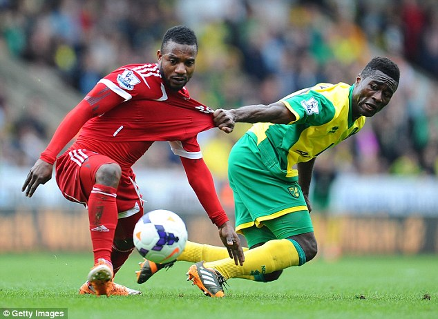 Tight tussle: Norwich's Alex Tettey (right) hold onto West Brom's  Stephane Sessegnon
