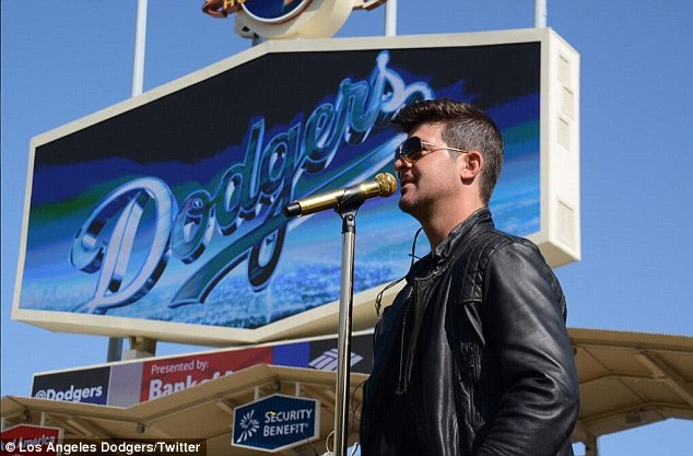 No blurred lines here: The R&B singer was set to perform three songs before the Dodgers vs San Francisco Giants game