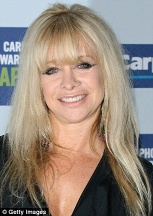 Jo Wood branded her ex-husband a 'weak man' after his lawyers have ordered her to dissolve her skincare company