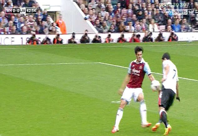 Correct decision: James Tomkins was fortunate to stay on the pitch after clearly handling the ball
