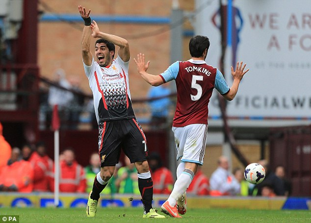 He touched it! Luis Suarez appeals to the referee for the handball leading to Liverpool's first penalty