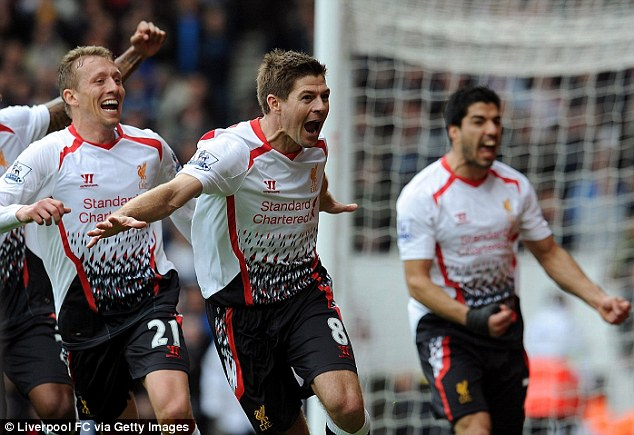 Red hot! Steven Gerrard (C) celebrates scoring the second penalty to give Liverpool a 2-1 victory
