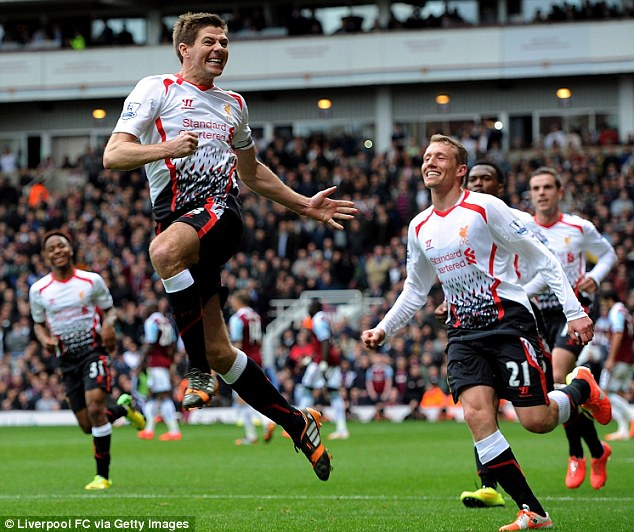 Title charge: Gerrard celebrates his second converted penalty at Upton Park as Liverpool went back to the summit