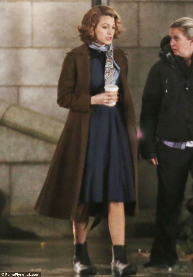 Looking the part: The actress swapped her Ugg-style boots for ankle-length wellingtons as she filmed The Age of Adeline