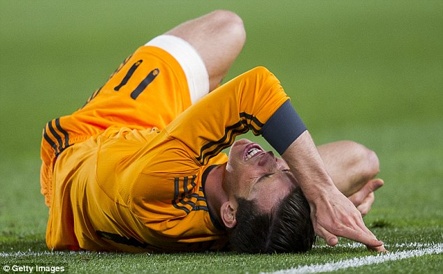 Pain game: The Wales international clutches his knee during Real Madrid's 4-0 victory at Real Sociedad