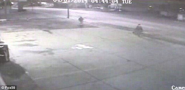 Attack: Security camera footage shows Trapuzzano, right, and one of the suspects, left, following him. A friend of the alleged killer said he told Nathan as he made him strip: 'Why you reaching for your shoes' and then shot him