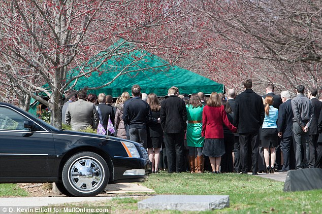 A community in mourning: Hundreds attended Trapuzzano's funeral over the weekend. Above, family and friends gather as he is laid to rest at Our Lady of Peace Cemetery in Indianapolis on April 5