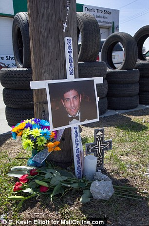 Remembering: Trapuzzano's family and friends have erected a make-shift memorial near the site where he was killed