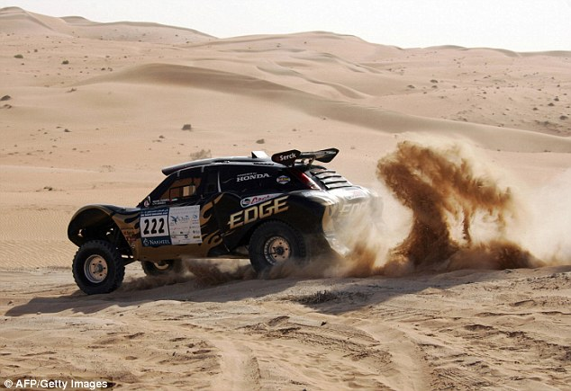 Four wheels: Britain's Mark Powell and Tim Ansell drive their Honda in the UAE Desert Challenge