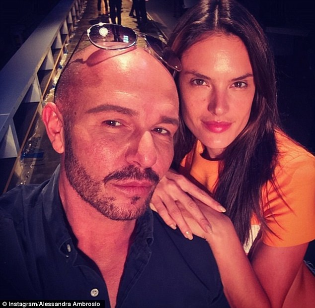 Star of the show: Alessandra Ambrosio posed with Australian designer Alex Perry ahead of heading down the catwalk to open and close his Mercedes-Benz Fashion Week Australia show in Sydney on Monday