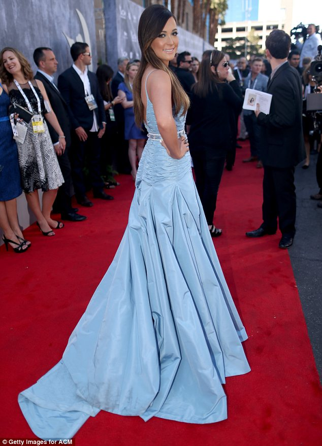 Belle of the ball: Kacey Musgraves, who was a double winner at the Grammy Awards, dressed to impress on her big night