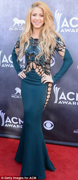 Surprise attendee: Shakira, who has collaborated with her The Voice co-star and country music superstar Blake Shelton, on her latest album, arrived in a revealing full-length dress with cut-out panels down the sides