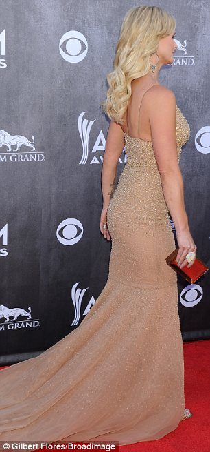 Knockout: Miranda Lambert was a knockout, looking better and slimmer than ever in a plunging nude dress which showed off her incredible figure