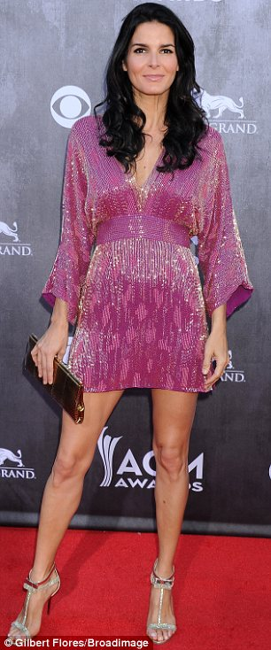 Total opposites: White Jewel opted for a plunging floor length, Angie Harmon showed off her legs in a short pink dress