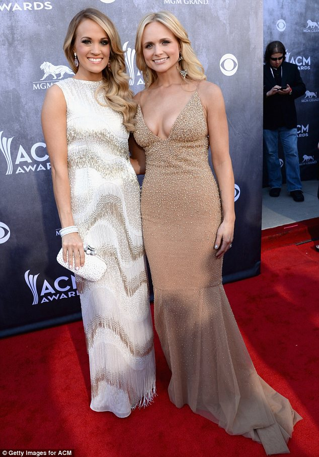 Sequinned stars: Carrie and Miranda cosied up on the red carpet in their sequinned gowns