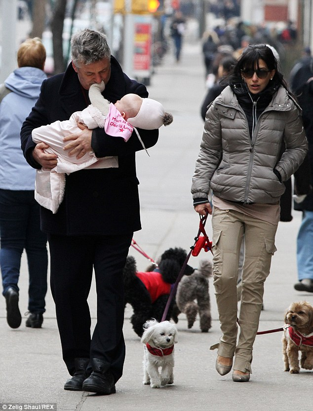 That's my daughter! The 30 Rock actor doted upon his adorable infant daughter as she reached towards his face in New York in March