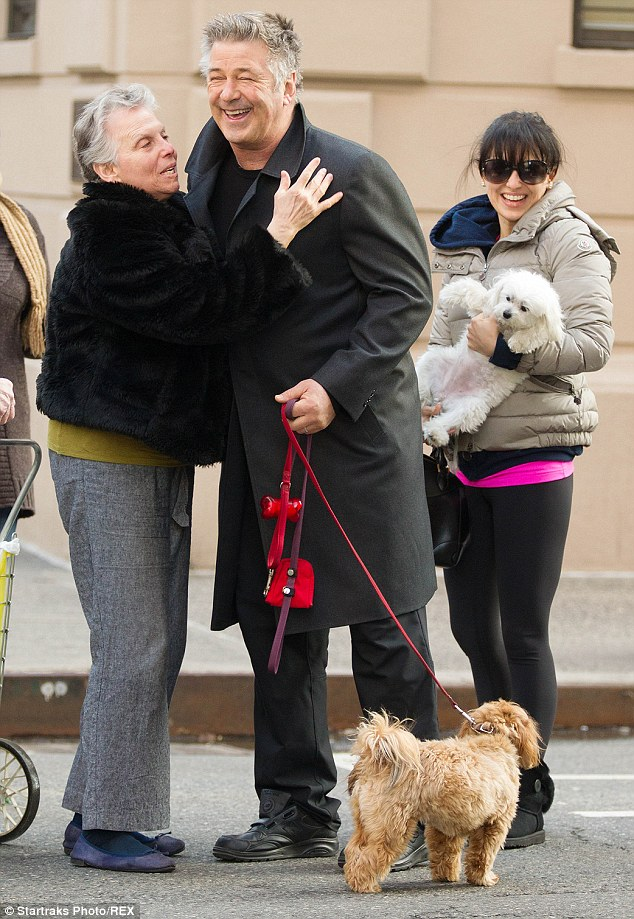 Puppy love! The silver-haired actor smiled as a fan approached him on the street in New York in April