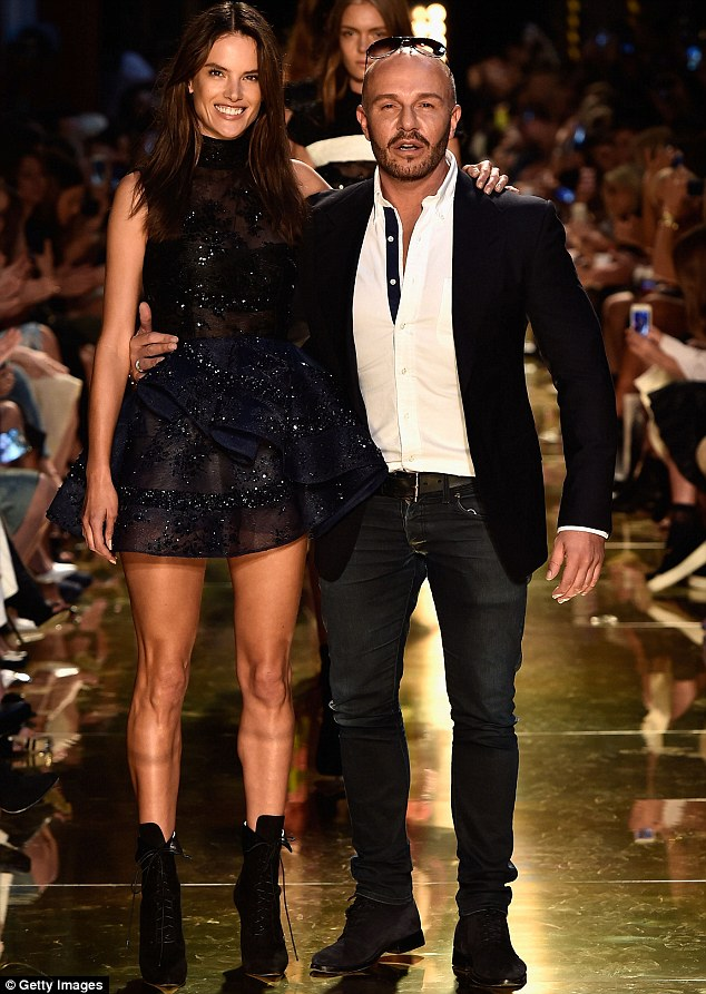 A fashionable moment: Alessandra and Alex posed together on the catwalk as she closed the spectacular presentation of his Spring/Summer 14/15 collection