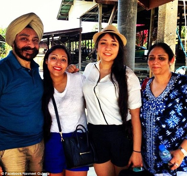 On holiday: Navneet (right) wears the ring on a previous family holiday