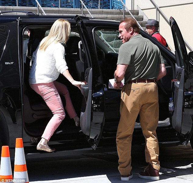 In you get: Arnie kept a close eye on Heather as she got into the vehicle to head home