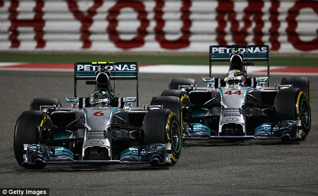 On track: Rosberg briefly got ahead of Hamilton, but the Briton snatched back the lead on the same lap