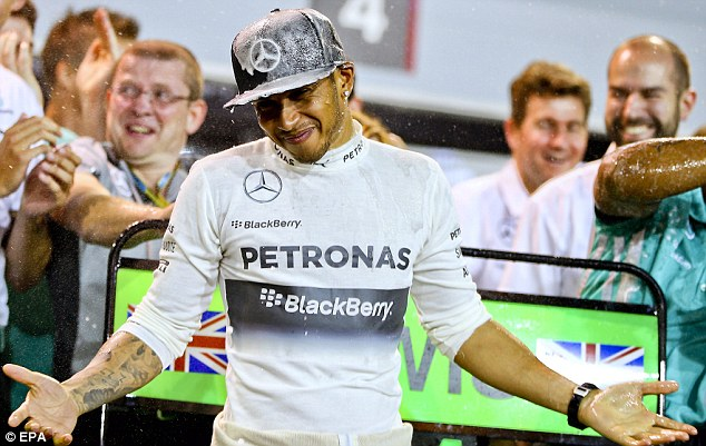 Champagne moment: Hamilton is drenched by his team after winning the Bahrain Grand Prix