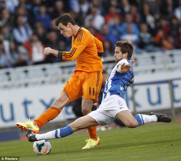 Rubbish: Gareth Bale's team say he will not have back surgery during the summer