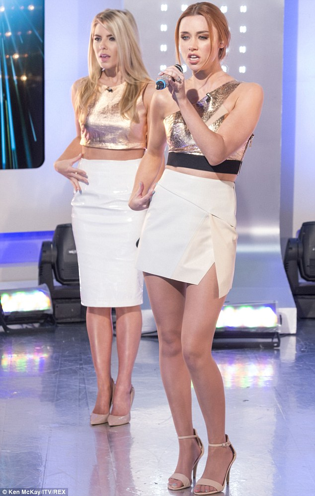 Daring: Una's legs looked endless in her white miniskirt, complete with daring thigh-split, and a golden asymmetrical top