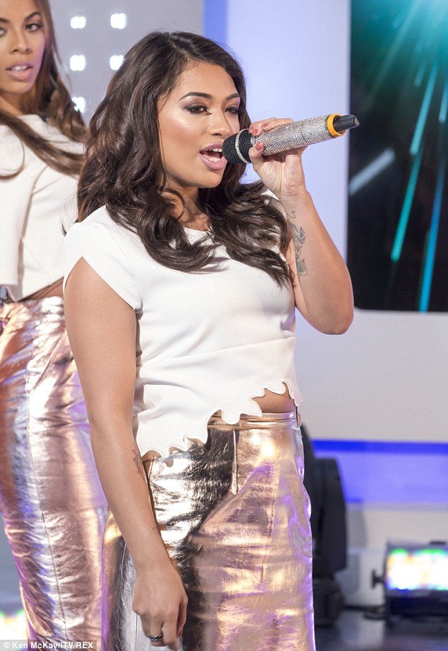 Crooner: Vanessa showed off her arm tattoos while belting out their latest track, which was released on Saturday