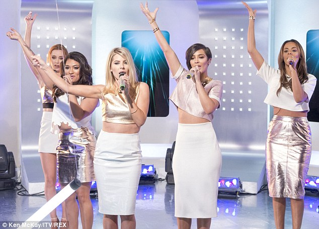 Hands up! Keeping it coordinated: Una Foden, Vanessa White, Mollie King and Rochelle Humes all opted for very similar ensembles to perform their latest single Not Giving Up