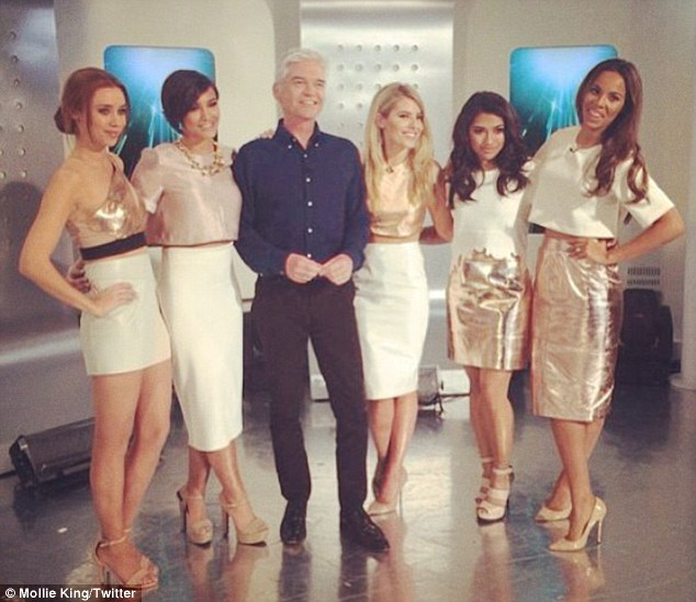 Ladies man: The five-piece posed for a snap with Phillip Schofield after their routine on the daily chat show