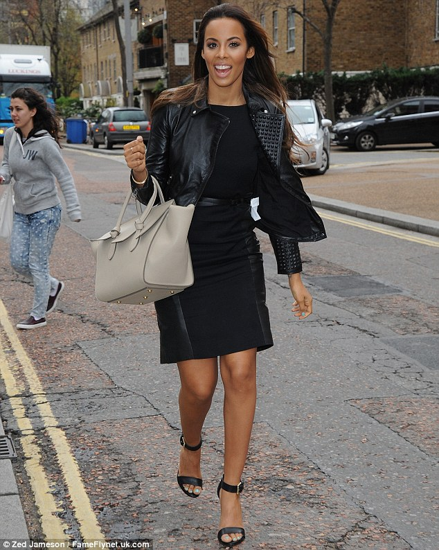 Always camera-ready: Rochelle swapped her daring stage look for a black studded jacket and pencil skirt, with leather side panels