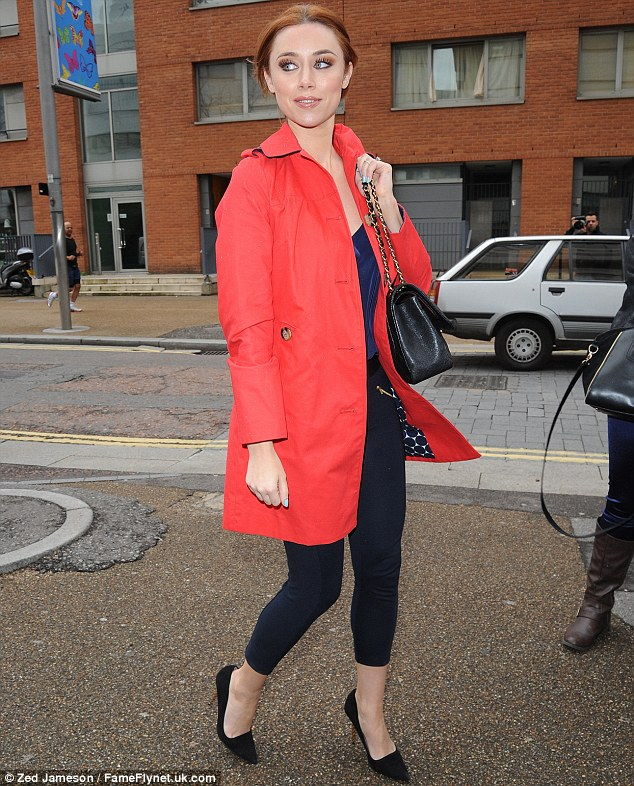 Attention stealer: The Irish beauty appeared to be distracted by something as she clutched her quilted handbag