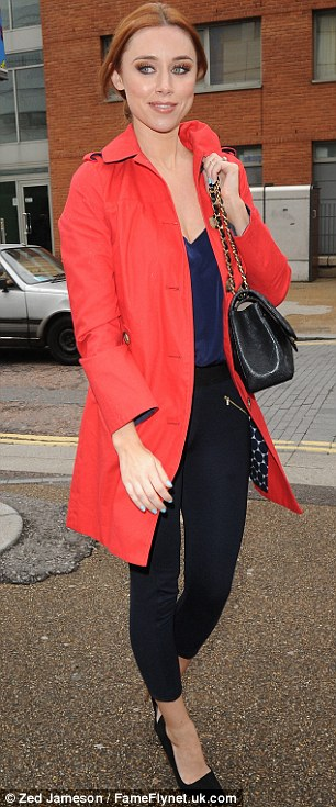 Keeping covered: Una left in a vibrant orange mac, black leggings and navy camisole