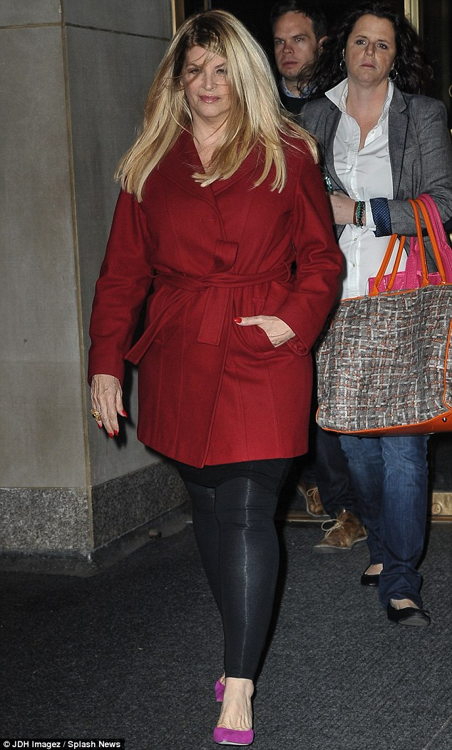 Ready in red: The Look Who's Talking actress was spotted leaving the Today show on Monday morning