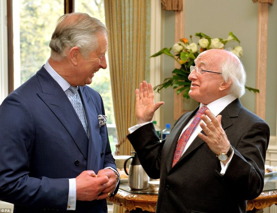 Historic: The President of Ireland Michael D Higgins shares a laugh with the Prince of Wales at the Irish Embassy in central London at the start of his state visit