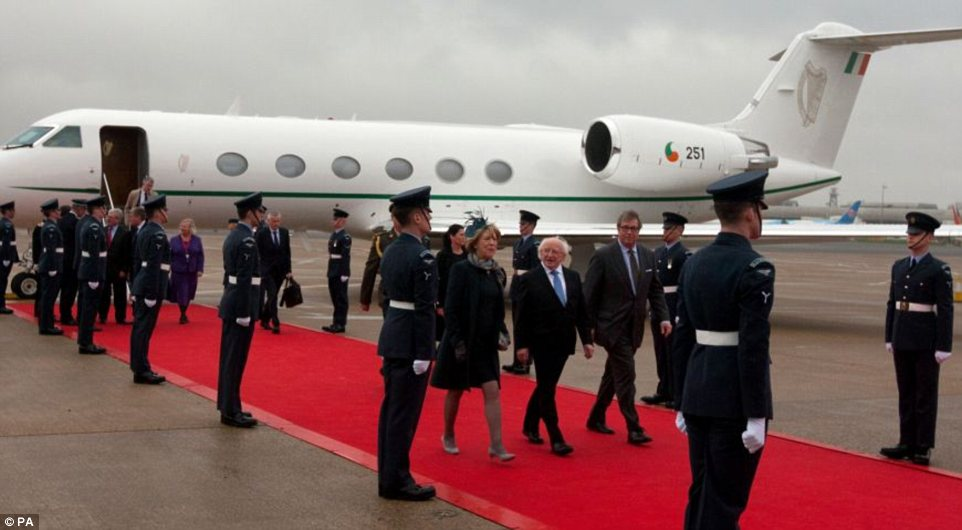 Touch down:  Michael D Higgins, accompanied by his wife Sabina Higgins, arrive at London Heathrow Airport this morning