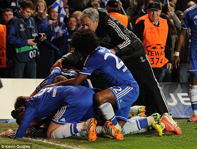 Wild scenes: Mourinho dashes to celebrate with his jubilant players after Ba's dramatic goal