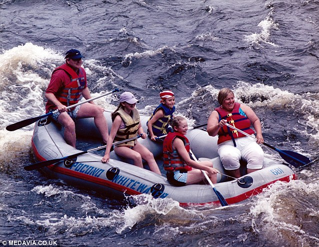 Sarah rafting with her children after the the instructor could not find a life jacket to fit her, eventually fitting her in an extra-large life preserver