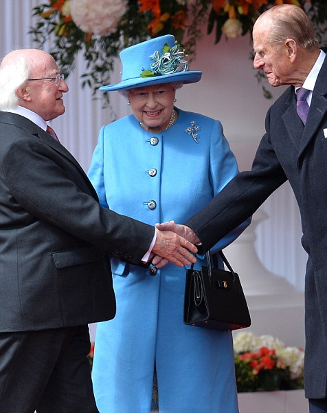 The Ceremonial Welcome in Windsor for the Irish State Visit. The Queen and The Duke of Edinburgh formally greet The President and Mrs Higgins at the Royal Dais in Datchet Road, Windsor.