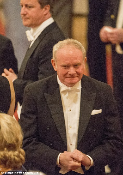 Controversial: Dressed in his evening  finery, ex-IRA commander Martin McGuinness was a guest of the Queen at Windsor Castle at a State Banquet to honour Ireland's President Michael D Higgins and mark the first visit by an Irish head of state to Britain. Among the guests was Prime Minister David Cameron, pictured in the background