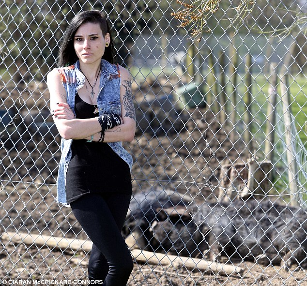 Devastated: Ria Dell is pictured above outside the enclosure where she used to visit her porcine friend