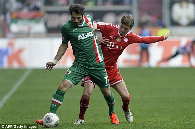 Tussle: Krros attempts to get the ball from Augsberg;s Halil Altintop in Saturday's Bundesliga clash
