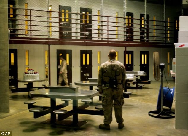 Guards keep watch inside a cell block at Camp 5 maximum security facility, at Guantanamo Bay, in 2007. Mr Aamer was arrested by Afghan militias working for the Americans shortly after the 2001 invasion of Afghanistan